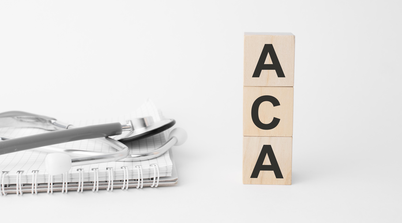 ACA written on wooden blocks